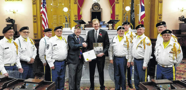 David Root, VFW State Commander, on Monday presents the State Commendation for Service to Ohio state and the nation at the inauguration ceremony for the Ohio House of Representatives along with the Gallipolis 4464 VFW Honor Guard doing the Pledge of Allegiance Ceremony. State Representative Ryan Smith stands with Root and the honor guard.