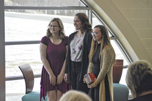 From left to right stand River Valley High Schools Poetry Out Loud placers, third place Rebecca Pierce, second place Kristen Clark and first place, Chevy Barnes.