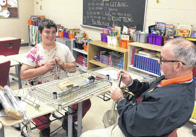 A South Gallia student assists with the construction of a cart utilized by Rebel Roast.