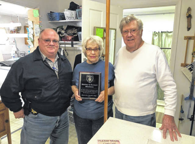 Sheriff Greg Powers pictured with Howard and Shirley Meadows after they were presented with their appreciation plaque from the Mason County Sheriff's Department.