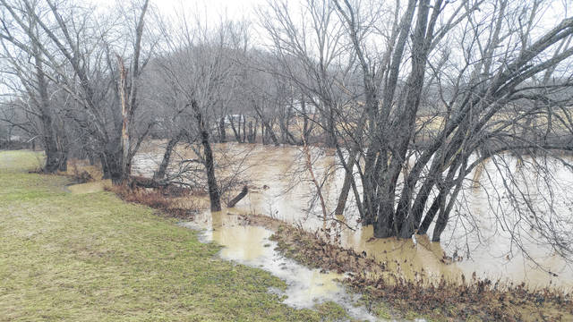 Raccoon Creek overflows Wednesday afternoon during a long cycle of rain.
