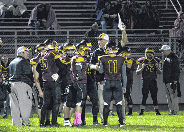 Coach Mike Bartrum, center, talks to his team during a game during the 2018 season.