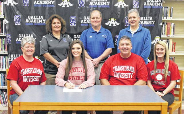 On Monday at GAHS, senior Hunter Copley signed her National Letter of Intent to join the Transylvania University softball team. Sitting in the front row, from left, are Michelle Copley, Hunter Copley, John Copley and Chelsea Copley. Standing in the back row are GAHS athletic trainer Lori Ward, Blue Angels softball coach Scott Stanley and Gallia Academy golf coach Mark Allen.