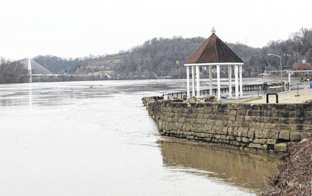 The Ohio River revisits the parking lot wall and upper gazebo in Pomeroy.