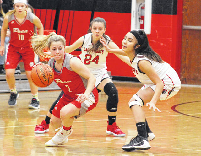 Point Pleasant defenders Brooke Warner (24) and Naomi Meisser apply pressure to a Poca player during the first half of Tuesday night's girls basketball contest in Point Pleasant, W.Va.