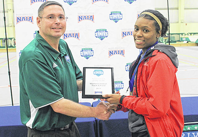 River States Conference commissioner Michael Schell presents Rio Grande junior Chanavier Robinson with the RSC Women's Indoor Track & Field Newcomer of the Year Award at the close of Friday's RSC Indoor Track & Field Championships in Tiffin, Ohio.