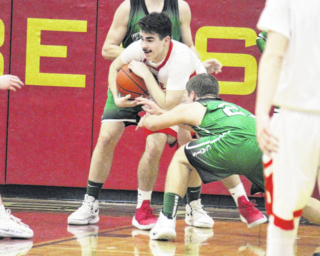South Gallia senior Gavin Bevan comes up with a steal, during the first half of the Rebels' 59-35 setback on Tuesday in Mercerville, Ohio.