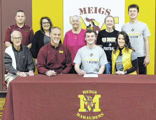 On Thursday at Meigs High School, senior Zach Bartrum signed his National Letter of Intent to join the Ohio Dominican University football team. Sitting in the front row, from left, are Weldon Bartrum, Mike Bartrum, Zach Bartrum and Jennifer Bartrum. Standing in the back are Meigs athletic director Kevin Musser, MHS guidance counselor Abby Harris, Joyce Bartrum, Taylor Bartrum and Ty Bartrum.