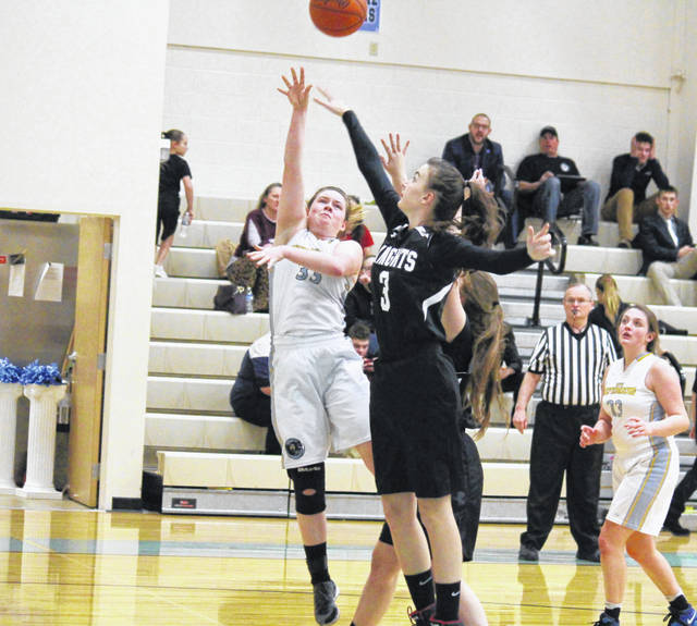 OVCS senior Emily Childers (33) tries a two-pointer over a pair of Lady Knights, during the Lady Defenders' 22-12 victory on Feb. 11 in Gallipolis, Ohio.