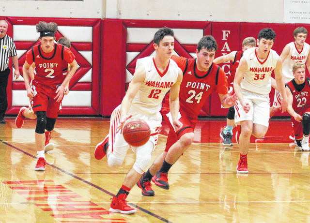 Wahama senior Abram Pauley (12) dribbles ahead of the pack on a fast break attempt during the first half of a Feb. 15 boys basketball contest against Point Pleasant at Gary Clark Court in Mason, W.Va.