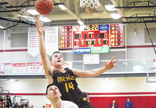 Meigs senior Zach Bartrum (14) sinks the first bucket of the D-3 sectional final on Friday in Jackson, Ohio.