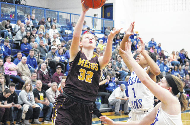 Meigs freshman Mallory Hawley (32) goes for a layup, during the Lady Marauders' 60-49 setback to Washington in the D-2 district semifinal on Thursday in Londonderry, Ohio.