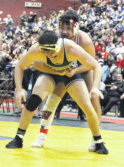 Wahama senior Antonio Serevicz maintains leverage on an opponent during the Class AA-A 220-pound final on Saturday night at the 2019 WVSSAC Wrestling Championships held at Big Sandy Superstore Arena in Huntington, W.Va.