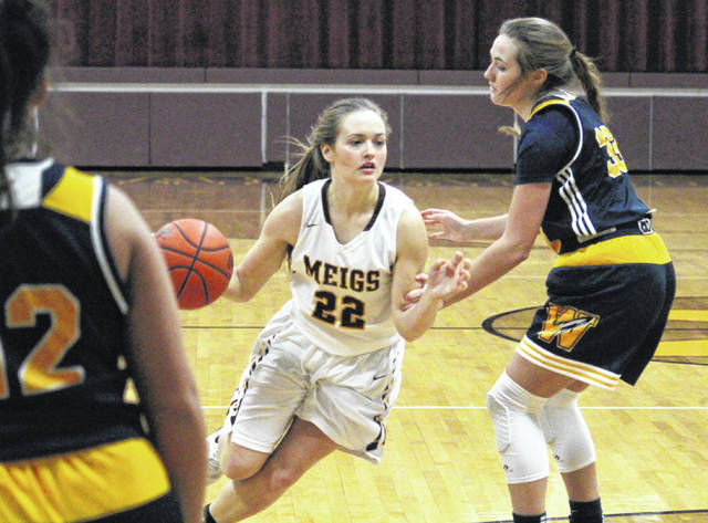 MHS senior Taylor Swartz (22) drives between a pair of Wellston defenders, during the Lady Marauders' 65-21 victory on Thursday in Rocksprings, Ohio.