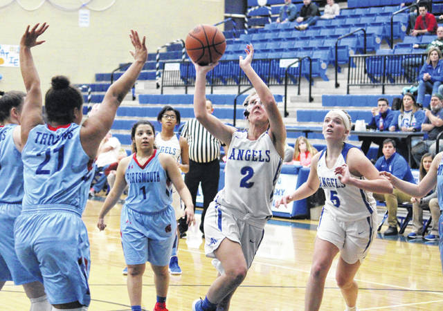 GAHS senior Abby Cremeans (2) sinks a two-pointer in front of teammate Maddy Petro (5), during the Blue Angels' 38-27 setback on Monday in Centenary, Ohio.