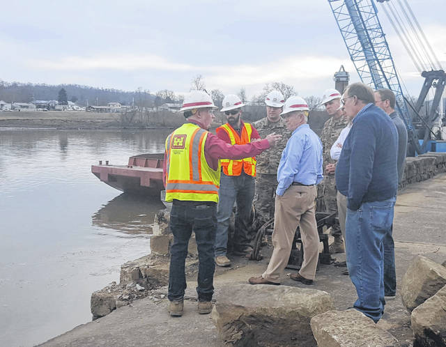 Mike Spoor, left, discusses the riverbank stabilization project with Congressman Bill Johnson on Monday afternoon.