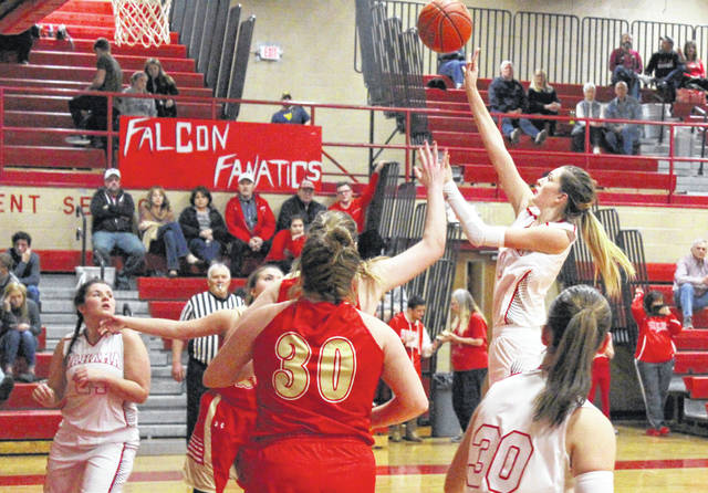 Wahama sophomore Emma Gibbs releases a shot attempt over a pair of South Gallia defenders during the first half of Monday night's girls basketball contest at Gary Clark Court in Mason, W.Va.