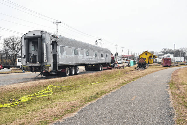 Volunteers work to unload a former Ringling Brothers and Barnum and Bailey's Circus passenger car at the Gallipolis Railroad Freight Station Museum.