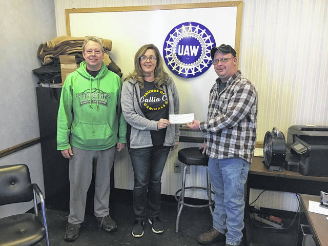 United Auto Workers at GKN in Gallipolis present Friends of Gallia County Animals with a check for $500 for their ongoing work with area animals.