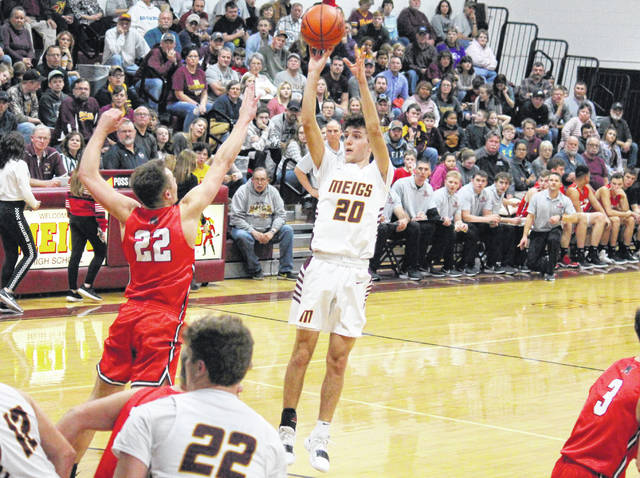 MHS junior Weston Baer (20) attempts a shot from the top of the key, during the Marauders' Jan. 18 loss to Alexander in Rocksprings, Ohio.