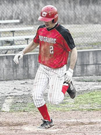 Rio Grande's Kent Reeser scores a run in Sunday's game two loss to Point Park University at Bob Evans Field. The Pioneers swept the twinbill by scores of 10-6 and 7-4.