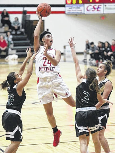 Canton McKinley senior Kierstan Bell (24) releases a shot attempt over a trio of defenders in this undated photo.