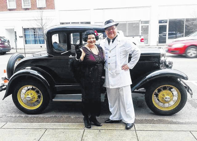 "Annie Roach and her husband, Gary, in front of the antique car at last year's ""Roaring Twenties"" fundraiser event and silent auction for the French Art Colony."