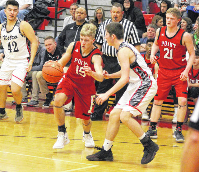 Point Pleasant senior Bradyn Canterbury (15) dribbles past a Nitro defender as classmate Jordan Daubenmire (21) looks on during the second half of Thursday night's Class AA Region IV, Section 1 semifinal contest in Nitro, W.Va.