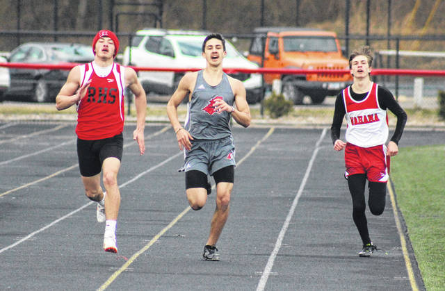 Wahama's Josh Frye (right), Point Pleasant's Nick Leport (center) and Ravenswood's Austin Garrett (left) race down the final straightaway, during 400m dash on Friday in Point Pleasant, W.Va.