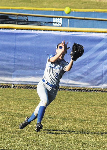 Gallia Academy junior Chasity Adams runs down a centerfield pop-up for an out during the third inning of Wednesday night's softball contest against Athens in Centenary, Ohio.