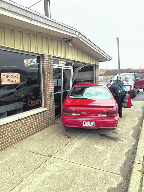A vehicle crashed into the front of the Heiner's Bakery building at 1708 Eastern Avenue in Gallipolis on Friday morning causing damage to the building around 9:30 a.m. Gallipolis Police Department, Gallia County EMS and other first responders were on the scene. The car was later removed, leaving a hole in the front of the building. Gallipolis police report that the driver was cited with failure to maintain control as well as failure to maintain an assured distance as the driver reportedly hit another vehicle's rear end before driving on into the Heiner's Bakery window. Heiner's Bakery representatives offered no comment and the identity of the driver has not been released as of this time. Reportedly the driver refused medical treatment.