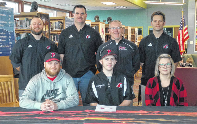 Point Pleasant senior Carter Smith, seated center, will be continuing his baseball career after signing a letter of intent with the University of Rio Grande on Sunday, March 3, at the PPHS library. Carter is joined in front by his parents, Ian and Amanda Smith of Point Pleasant. Standing in back, from left are PPHS assistant Dante Fuscardo, PPHS assistant Bryan Morrow, Rio Grande baseball coach Brad Warnimont, and PPHS baseball coach Andrew Blain.