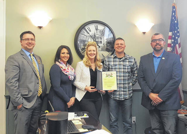 Kelly Smith, center, the representative for Ohio Treasurer Robert Sprague presented a recognition to the Meigs County Commissioners and Bicentennial Committee during the recent Meigs County Commissioner Meeting. Sprague is the first of the state officials to present official recognition of the Bicentennial.