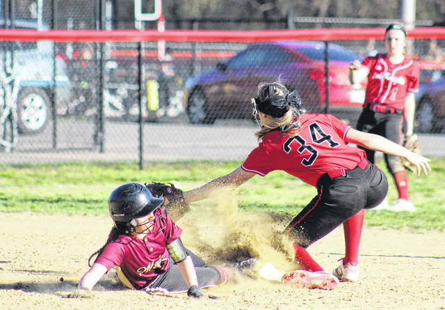 Meigs sophomore Breanna Lilly (left) slides safely into second base for a double in front of PPHS freshman Tayah Fetty (34), during the Lady Knights' 9-1 triumph on on Tuesday in Point Pleasant, W.Va.