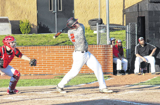 Point Pleasant senior Brody Jeffers (2) follows through on his grand slam home run, during the Big Blacks' 17-2 victory on Tuesday in Point Pleasant, W.Va.
