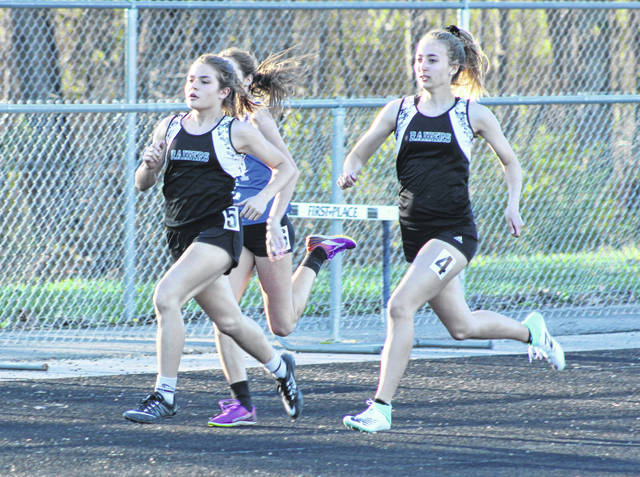 The River Valley duo of Lauren Twyman (5) and Savannah Reese (4) both hit full stride during the 800m event held Monday night at the 2019 Gallia County Meet in Bidwell, Ohio.
