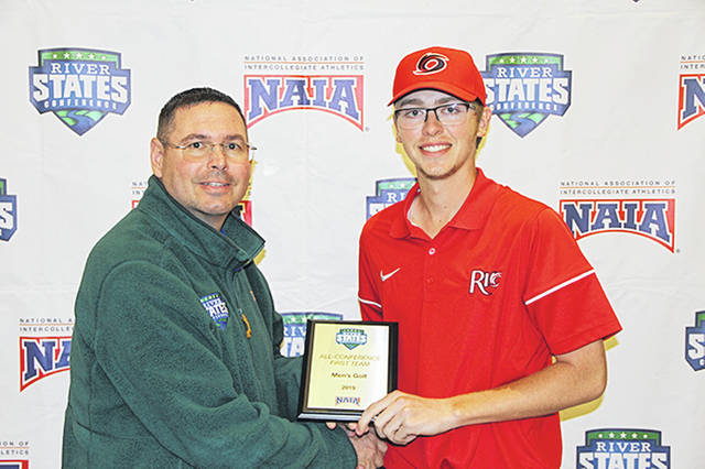 River States Conference commissioner Michael Schell presents Rio Grande's Jarod Lemaster with his All-RSC First Team award following Tuesday's final round of the RSC Men's Golf Championship at Belterra Golf Course in Florence, Ind.