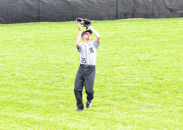 River Valley senior Wyatt Halfhill grabs a flyball in left field, during the Raiders' three-run setback on Wednesday in Rocksprings, Ohio.