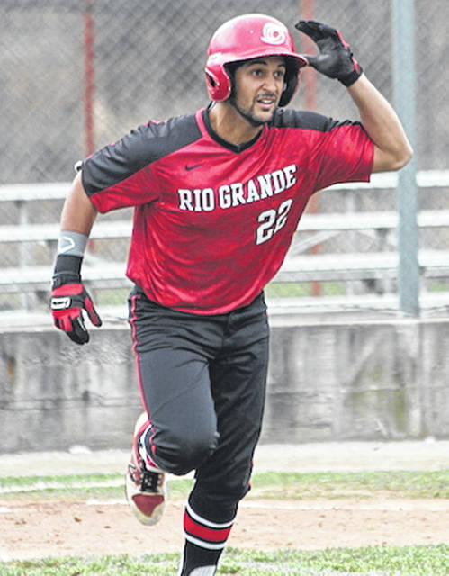 Rio Grande's Michael Rodriguez heads to first base after hitting a third inning single in Friday's 17-10 loss to Midway University at Bob Evans Field.