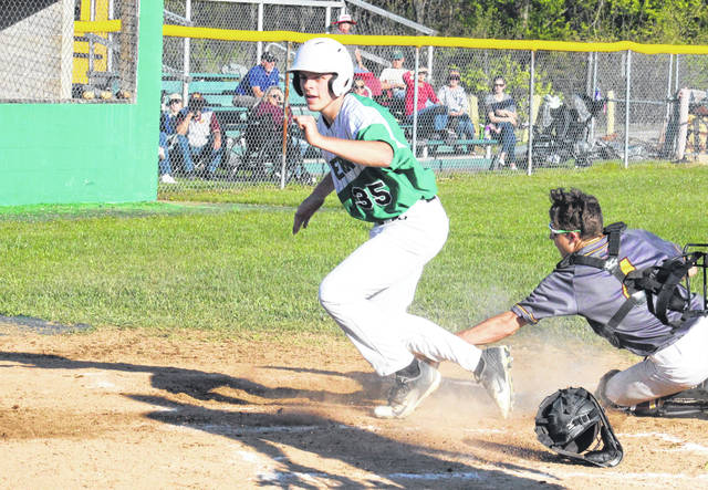 Eastern senior Isaiah Fish (35) crosses home plate behind the Federal Hocking catcher, during the Eagles' 9-2 victory on Monday in Tuppers Plains, Ohio.