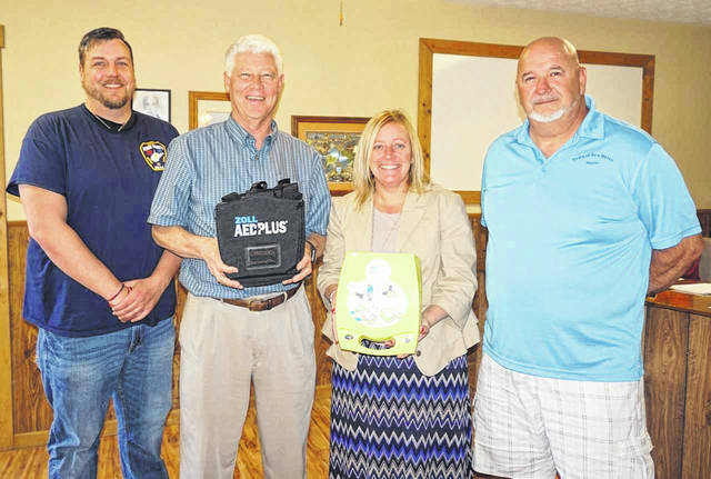 Rick and Tanya Handley recently donated an automated external defibrillator (AED), extra pads, and a cabinet to hold the device to the Town of New Haven. The AED will be used at the municipal swimming pool, as well as the adjoining community building. Pictured, from left, are Matt Shell, council member and recreation director; Rick and Tanya Handley; and Mayor Greg Kaylor.