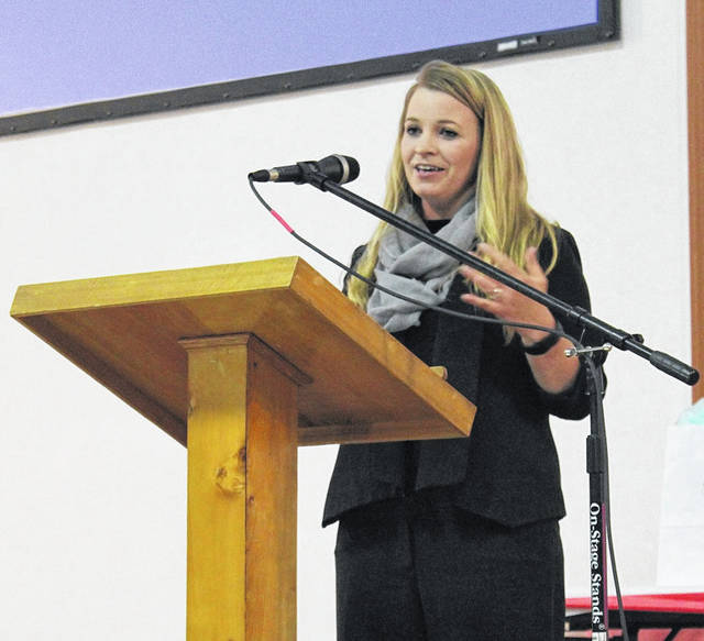 Jessica Lynch, veteran and former Prisoner Of War, tells her story to those attending Thursday's Mason County Area Chamber of Commerce dinner and awards banquet.