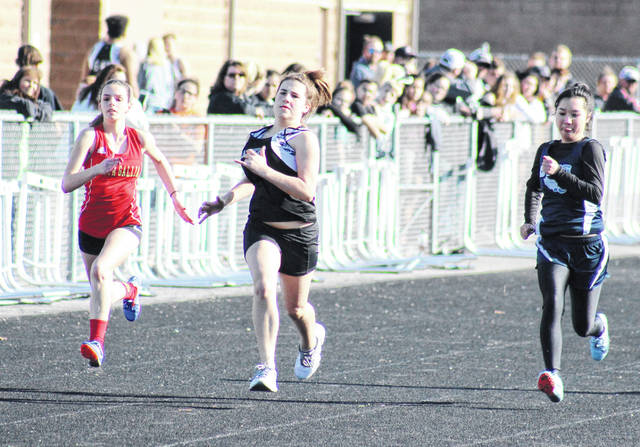 South Gallia's Emily Riggle (left), River Valley's Grace Bays (center), and Ohio Valley Christian's Amy Dong (right) compete in the 100m dash on Tuesday in Bidwell, Ohio.