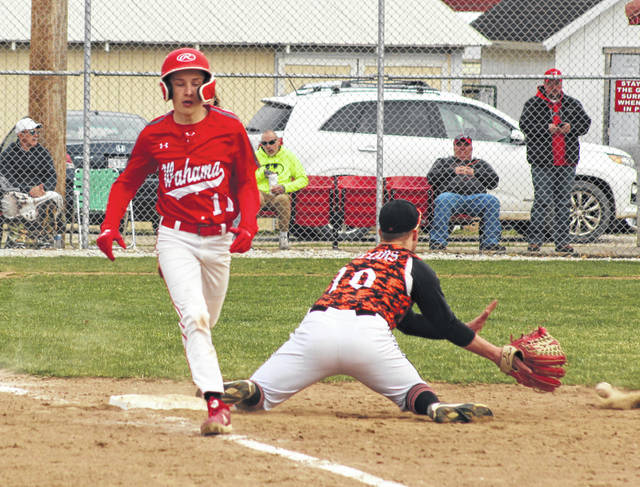 Wahama junior Brayden Davenport (11) beats out a throw for an infield single during the fourth inning of Thursday night's TVC Hocking baseball game against Belpre at Claflin Stadium in Mason, W.Va.