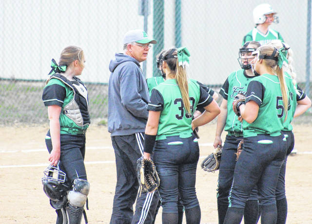 Eastern head coach Bryan Durst talks with the Lady Eagle infield, during a victory over Waterford on March 29 in Tuppers Plains, Ohio.