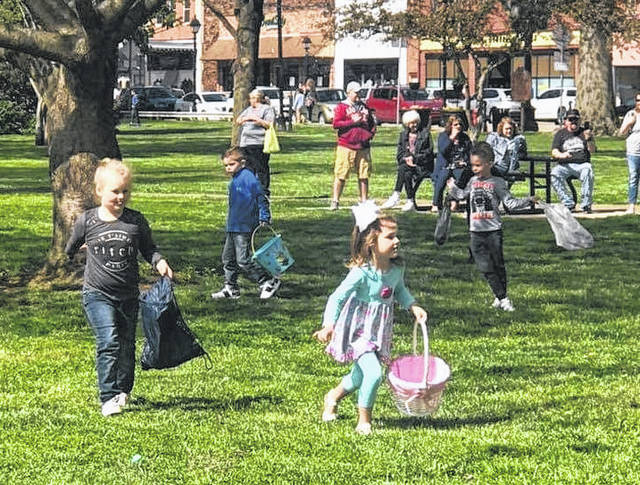 Youth run about the Gallipolis City Park Saturday at the annual City Park Easter Egg Hunt put on between a partnership with the Gallipolis Recreation and Parks Department as well as the Gallipolis Junior Women's Club. A bake sale and games were also held at the event.