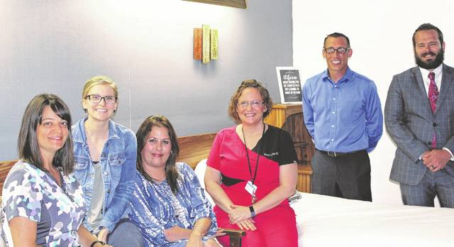 Pictured in one of the newly opened patient rooms in New Life Clinic's Hope for Tomorrow detox unit are staff and administration, from left, Melissa Taylor, Hannah Marburger, Angela Yates, Barbie Rickard, Todd Bowen, Andrew Dornbos. The facility is located just north of Point Pleasant.