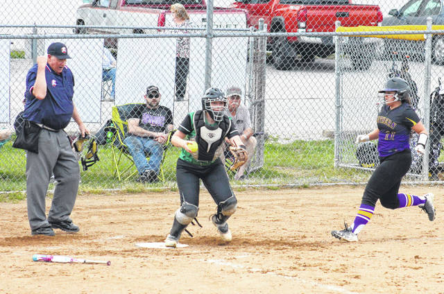 Eastern sophomore Kelsey Roberts (center) steps on home plate for a force out, in front of Southern junior Sydney Adams (11), during the Lady Eagles' 10-0 victory on Monday in Tuppers Plains, Ohio.