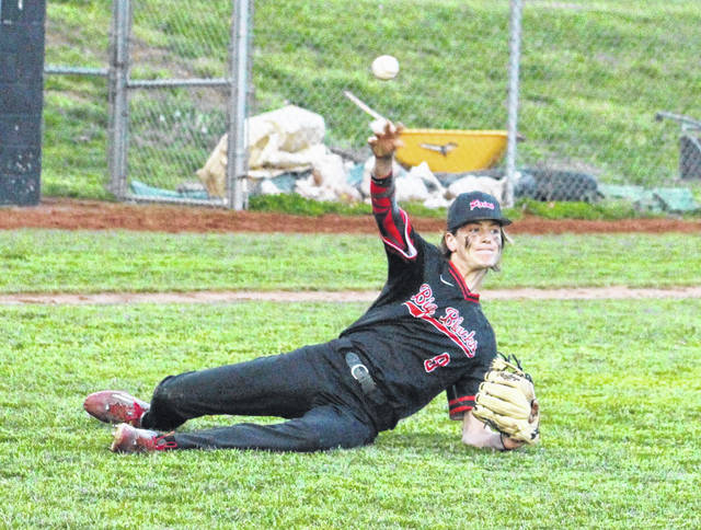 Point Pleasant sophomore Kyelar Morrow releases a throw to first after slipping while fielding a bunt attempt during Tuesday night's game against Poca in Point Pleasant, W.Va.