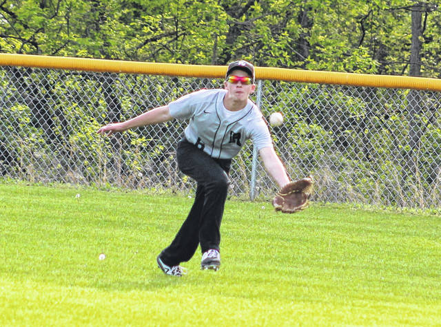Freshman John Santos (6) lunges to make a catch in right field during the fifth inning of Wednesday night's TVC Ohio baseball contest against Athens in Bidwell, Ohio.